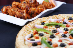 Pizza and wings Royalty Free Stock Images