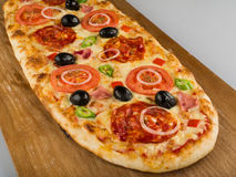 Pizza on wodden deck Stock Photography