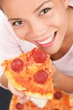 Pizza Woman. Woman eating a slice of pepperoni pizza. Beautiful mixed race chinese / caucasian model royalty free stock image