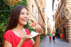Pizza woman eating pizza slice in Rome, Italy. Smiling happy outdoors during travel vacation holiday. Beautiful mixed race Asian Caucasian woman enjoying Stock Photography