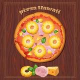 Pizza on the wood background with ingredients. Royalty Free Stock Image