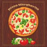 Pizza on the wood background with ingredients. Royalty Free Stock Photo