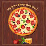 Pizza on the wood background with ingredients. Stock Photo
