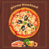 Pizza on the wood background with ingredients. Royalty Free Stock Photos