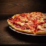 Pizza on wood background Stock Photo