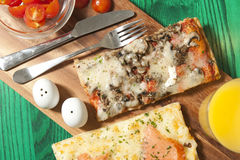 Pizza on a wood board Royalty Free Stock Photography
