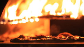 Pizza in a wood fire oven stock footage