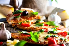 Pizza on wood with ingredients royalty free stock photos