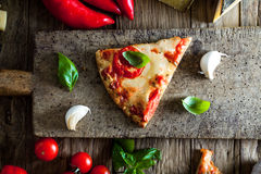 Pizza on wood with ingredients Royalty Free Stock Photography