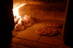 Pizza in wood oven Stock Photo