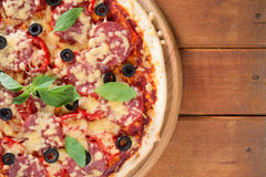 Pizza. On a wooden background Royalty Free Stock Photos