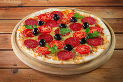 Pizza. On a wooden background Royalty Free Stock Photo
