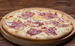 Pizza. On a wooden background Royalty Free Stock Image