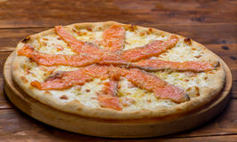 Pizza. On a wooden background Stock Photo