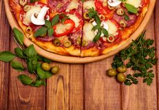 Pizza on wooden background Stock Photo