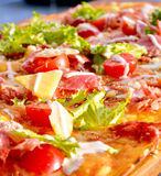 Pizza on wooden board royalty free stock photos