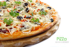 Pizza on wooden plate Stock Photography