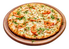 Pizza on wooden plate Royalty Free Stock Photos