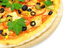 Pizza on wooden plate isolated Stock Images