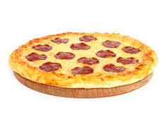 Pizza on wooden round board Royalty Free Stock Images