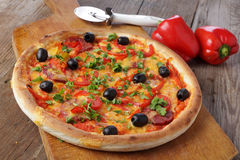 Pizza on wooden table Stock Photo