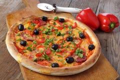 Pizza on wooden table. Hot Pizza on wooden table stock photo