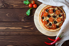 Pizza on wooden table Stock Photography