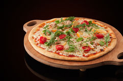 Pizza on a wooden tray Stock Photos