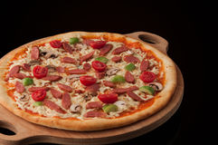 Pizza on a wooden tray Royalty Free Stock Images