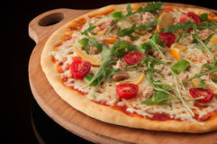 Pizza on a wooden tray Royalty Free Stock Photo