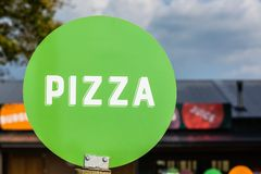 Pizza Word Green Disk Sign Stock Photos