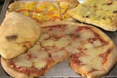 Pizza y calzone Foto de archivo libre de regalías