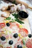 Pizza y los ingredientes Imagen de archivo libre de regalías