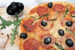 Pizza y los ingredientes Foto de archivo