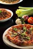 Pizza y pastas imagenes de archivo