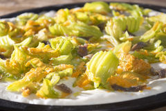 Pizza with zucchini flowers Stock Photo