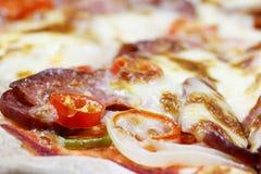 Pizzabovenste laagjes Stock Afbeelding