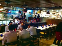 PizzaExpress Restaurant, Ambience Mall, Vasant Kunj, New Delhi. Customers at the PizzaExpress Restaurant, Ambience Mall, Vasant Kunj, New Delhi, India Stock Image