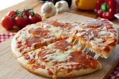 Pizzahandtag Arkivbild