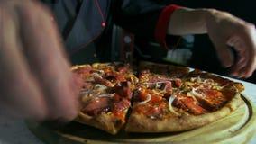 Pizzaiolo preparing pizza for serving stock video