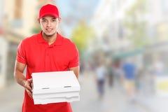Pizzajungen-Zustelldienst-Lateinmannauftrag, der Job liefert, Kastenstadt-copyspace Kopienraum zu liefern stockfotografie