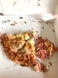 Pizzaplakken in doos royalty-vrije stock afbeelding