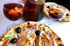 Pizzas. Pizza and sangria served in an italian restaurant Stock Photography