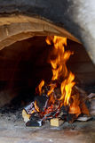 Pizzas baking in an open firewood oven Royalty Free Stock Photos