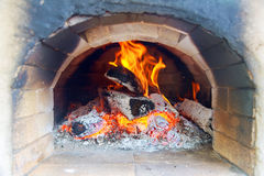 Pizzas baking in an open firewood oven Stock Image