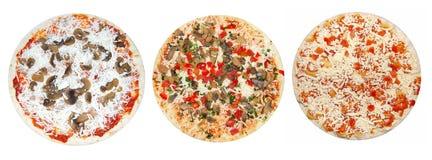 Pizzas non préparées Photographie stock libre de droits