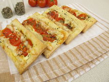 Pizzas from puff pastry with tomato and cheese Stock Photos