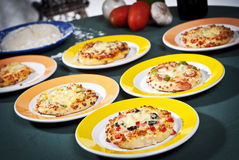 Pizzas. Several small pizzas foood red Royalty Free Stock Photo