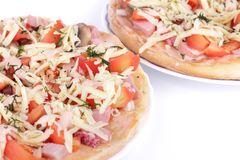 Pizzas with tomatoes, sauce, ham, sausage, cheese, Stock Images