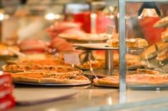 Pizzas under shopping window in restaurant Stock Photos
